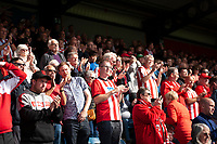Lincoln City fans watch their team in action<br /> <br /> Photographer Andrew Vaughan/CameraSport<br /> <br /> The EFL Sky Bet League One - Wycombe Wanderers v Lincoln City - Saturday 7th September 2019 - Adams Park - Wycombe<br /> <br /> World Copyright © 2019 CameraSport. All rights reserved. 43 Linden Ave. Countesthorpe. Leicester. England. LE8 5PG - Tel: +44 (0) 116 277 4147 - admin@camerasport.com - www.camerasport.com