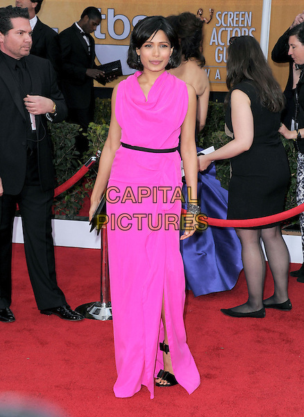 Freida Pinto (wearing Roland Mouret).Arrivals at the 19th Annual Screen Actors Guild Awards at the Shrine Auditorium in Los Angeles, California, USA..27th January 2013.SAG SAGs full length pink sleeveless dress black belt clutch bag draped .CAP/DVS.©DVS/Capital Pictures.