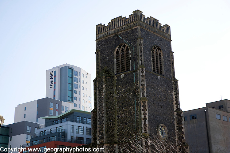 Contrast between old church tower and modern high rise building of the Mill, Ipswich, Suffolk, England