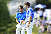 Rory McIlroy (NIR) and Padraig Harrington (IRL) finish their match on the 18th green during Friday's Round 2 of the 2014 Irish Open held at Fota Island Resort, Cork, Ireland. 20th June 2014.<br /> Picture: Eoin Clarke www.golffile.ie