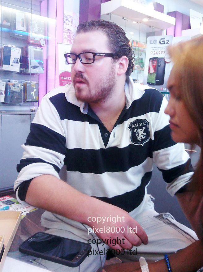 Internet Pic shows<br /> Rurik Jutting, black and white shirt.- with girlfriend, name unknown.<br /> <br /> The British banker arrested on suspicion of a double murder in Hong Kong has been identified as 29-year-old Cambridge University graduate Rurik Jutting <br /> <br /> <br /> <br /> Pic by pixel8000ltd