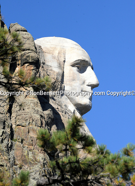 George Washington sculpture carved into granite at Mount Rushmore National Memorial,  Mount Rushmore near Keystone South Dakota, Mount Rushmore was sculpted by Gutzon Borglum and son Lincoln Borglum Mt, Rushmore features 60 foot sculptures of the heads of former United States Presidents George Washington Thomas Jefferson Theodore Roosevelt and Abraham Lincoln in Black Hills South Dakota, South Dakota is a state in Midwestern region of United States, named after Lakota and Dakota Sioux American Indian tribes, Fine Art Photography by Ron Bennett, Fine Art, Fine Art photo, Art Photography, Copyright RonBennettPhotography.com ©
