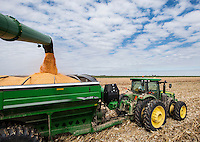 Seth Cavenee (cq, in blue, age 29), who recently returned to his home town of Tribune, Kansas, to be near his family and work on his farm, drives a combine during a corn harvest, Saturday, October, 12, 2013. The challenges of depopulation in the rural Midwest and Great Plains continue to grow as counties increasingly see more deaths than births. Greeley County, Kansas's least populated county, and the state as a whole are mounting a new fight to stem losses and finding early success. Sights and people of Tribune, Kansas.<br /> <br /> Photo by Matt Nager