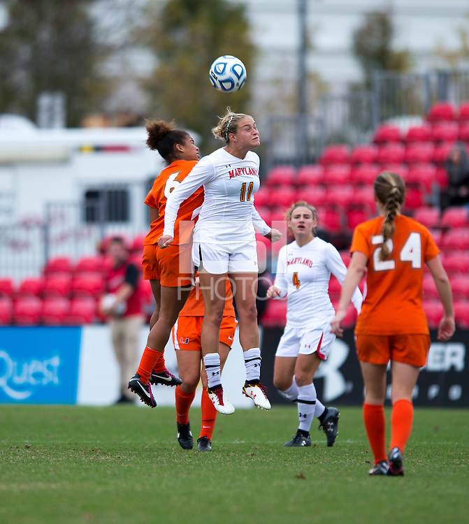Olivia Wagner (11) of Maryland goes up for a header with Jordan Roseboro (6) of Miami during the game at Ludwig Field in College Park, MD.  Maryland defeated Miami, 2-1, in overtime.