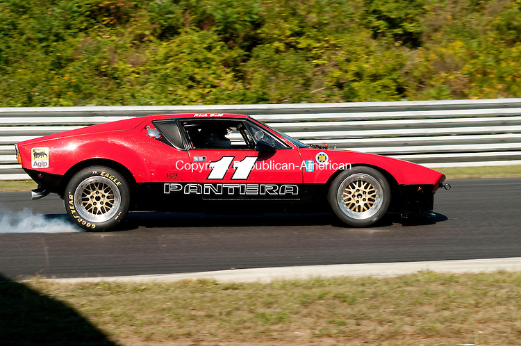 LAKEVILLE, CT, 06 SEPTEMBER, 2010-090610JS12-Rick Bell, of Salisbury, locks up the brakes in a 1972 Pantera GR4 going into Big Bend in the Wild Wild Horses, Big Bore Production and Detroit Dilemma race during the Historic Festival 28 at Lime Rock Park in Lakeville on Monday.  <br /> Jim Shannon Republican-American