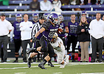 SIOUX FALLS, SD, OCTOBER 8:  Max Mickey #22 from the University of Sioux Falls scampers past Elijah McGeehan #38 from Southwest Minnesota State University in the first half Saturday night at Bob Young Field. (Photo by Dave Eggen/Inertia)
