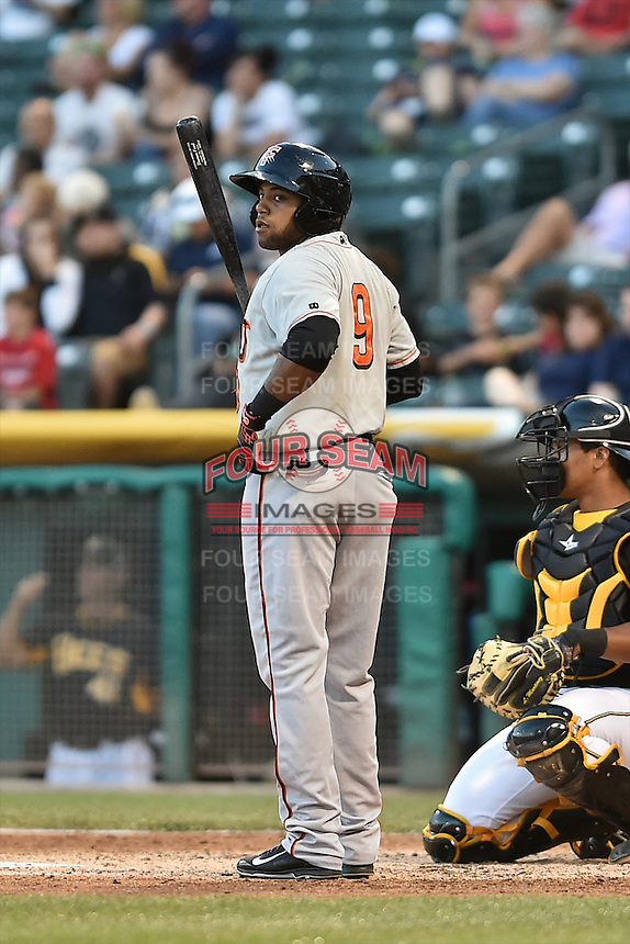Darren Ford (9) of the Fresno Grizzlies at bat against the Salt Lake Bees at Smith's Ballpark on May 25, 2014 in Salt Lake City, Utah.  (Stephen Smith/Four Seam Images)