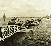 BNPS.co.uk (01202 558833)<br /> Pic: MitchellsAuctionHouse/BNPS<br /> <br /> PICTURED: The pier giving exit to Arromanches. The Mulberry Harbours were made up of six miles of steel roadways floating on concrete pontoons<br /> <br /> The fascinating archive of one of the engineers who designed the Mulberry Harbours which were installed off the Normandy coast following the D-Day landings has come to light.<br /> <br /> Colonel Vassal Charles Steer-Webster OBE helped create the giant, floating artificial harbours which protected anchored supply ships from German attacks.<br /> <br /> They were built in the dry docks on The Thames and Clyde and pulled across the channel by tugs before being hastily assembled.<br /> <br /> Col Steer-Webster was in almost daily contact with Churchill during their development ahead of June 6, 1944. Now, his personal effects, including a letter of thanks from Winston Churchill, are being sold by his nephew with Mitchells Auctioneers, of Cockermouth, Cumbria. <br /> <br /> The archive, which is expected to fetch £15,000, also features 150 photos showing Mulberry B's construction and use, as well as his medals.