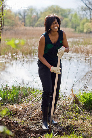 21 Apr 2009, Washington, DC, USA --- First lady Michelle Obama works with volunteers planting trees while participating in a national service project at Kenilworth Aquatic Garden in Washington, DC.       --- Image by © Brooks Kraft/Corbis