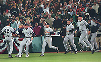 New York Yankee's rush to Mariano Rivera including Roger Clemens & others. The Yankees defeated the <br />Oakland Athletics..playoff, Oct 8, 2000. (photo/Ron Riesterer)