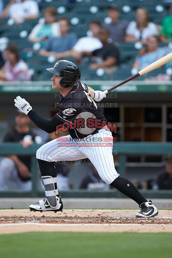 Mason Robbins (27) of the Charlotte Knights follows through on his swing against the Pawtucket Red Sox at BB&T BallPark on July 19, 2018 in Charlotte, North Carolina. The Knights defeated the Red Sox 4-3.  (Brian Westerholt/Four Seam Images)