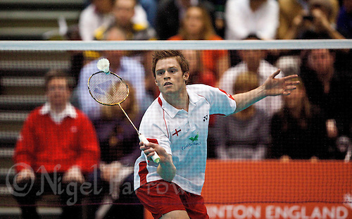 17 OCT 2009 - LOUGHBOROUGH, GBR - Andrew Smith returns during his mens singles match against Sasaki Sho at the Team England v Japan International (PHOTO (C) NIGEL FARROW)