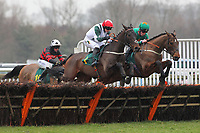 Kayaan ridden by Miss G Andrews (L) and Our Choice ridden by Harry Haynes in jumping action in the totepool Fakenham Silver Cup Handicap Hurdle