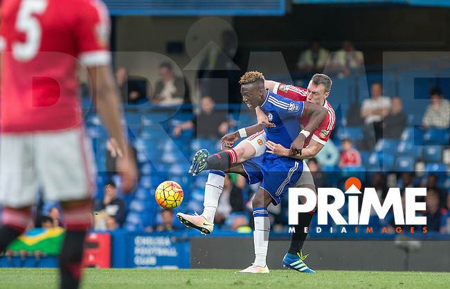 Phil Jones of Man Utd U21 holds onto Tammy Abraham of Chelsea U21  during the Barclays U21 Premier League match between Chelsea and Manchester United at Stamford Bridge, London, England on 6 May 2016. Photo by Andy Rowland.