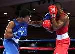Gary Russell, left, and Abraham Nova compete in the U.S. Olympic Boxing Trials in Reno, Nev., on Wednesday, Dec. 9, 2015. (AP Photo/Cathleen Allison)