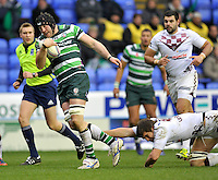READING, ENGLAND : George Skivington of London Irish tackled during the Amlin Challenge Cup match between London Irish and Bordeaux-Begles at Madejski Stadium on January 18, 2013 in Reading, England.