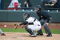 Winston-Salem Dash catcher Omar Narvaez (22) receives a pitch as home plate umpire Randy Rosenberg looks on during the game against the Potomac Nationals at BB&T Ballpark on April 30, 2015 in Winston-Salem, North Carolina.  The Nationals defeated the Dash 5-4..  (Brian Westerholt/Four Seam Images)