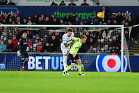 SWANSEA, WALES - JANUARY 19: Joe Rodon of Swansea City battles with Mark Duffy of Sheffield United during the Sky Bet Championship match between Swansea City and Sheffield United at the Liberty Stadium on January 19, 2019 in Swansea, Wales. (Photo by Athena Pictures/Getty Images)