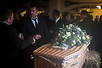 © Joel Goodman - 07973 332324 . 6 December 2013 . Marple , UK . The coffin inside the Royal Oak pub in Mellor . The funeral of farmer Bob Watson . His son David Watson drives his father's coffin on a trailer hooked to the back of Bob's favourite tractor through Marple via Bob's local pub before taking it on to the church . Photo credit : Joel Goodman