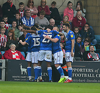 Macclesfield Town's Scott Wilson celebrates scoring the opening goal with team-mates<br /> <br /> Photographer Andrew Vaughan/CameraSport<br /> <br /> The EFL Sky Bet League Two - Lincoln City v Macclesfield Town - Saturday 30th March 2019 - Sincil Bank - Lincoln<br /> <br /> World Copyright © 2019 CameraSport. All rights reserved. 43 Linden Ave. Countesthorpe. Leicester. England. LE8 5PG - Tel: +44 (0) 116 277 4147 - admin@camerasport.com - www.camerasport.com