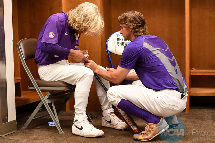 OMAHA, NE - JUNE 26: Zach Watson (9) of Louisiana State University helps Kramer Robertson (3) put tape on his bat as they prepare to take on the University of Florida during the Division I Men's Baseball Championship held at TD Ameritrade Park on June 26, 2017 in Omaha, Nebraska. The University of Florida defeated Louisiana State University 4-3 in game one of the best of three series. (Photo by Jamie Schwaberow/NCAA Photos via Getty Images)