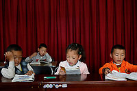 Lhasa, Tibet, China - Young Tibetan students attend free classes at a community centre in Lhasa, September 2018.