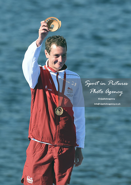 Alistair Brownlee celebrates winning the gold medal. Men's Triathlon at the 2014 Commonwealth Games. <br /> PHOTO: Mandatory by-line: Garry Bowden/SIPPA/Pinnacle - Tel: +44(0)1363 881025 - Mobile:0797 1270 681 - VAT Reg No: 183700120 - 240714 - Glasgow 2014 Commonwealth Games - Strathclyde County Park, Glasgow, Scotland, UK