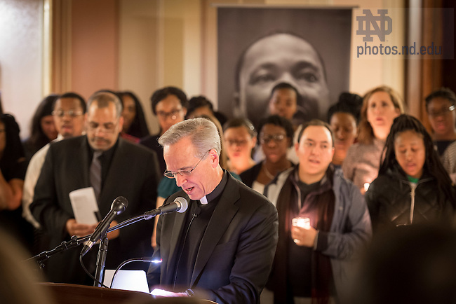 "January 16, 2017; Notre Dame President Rev. John I. Jenkins, C.S.C. leads The Lord's Prayer during a candlelight prayer service in the Main Building in observation of Martin Luther King Jr. Day. The event also marked the beginning of ""Walk the Walk"" week, a series of events an observances to celebrate and reflect on diversity and inclusiveness. (Photo by Matt Cashore/University of Notre Dame)"