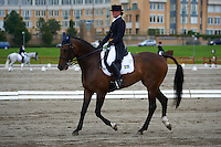 Jonna Friman (SWE) riding Lady-Grey during the dressage test at Malmo City Horse Show FEI World Cup Eventing Qualifier CIC***. <br /> The couple was with 51,48 % placed 39th after Friday's dressage.<br /> Eventing in Ribersborg, Malmo, Sweden. Ribersborg is very close to Malmo city seen in the background.<br /> August 2011.<br /> Only for editorial use.