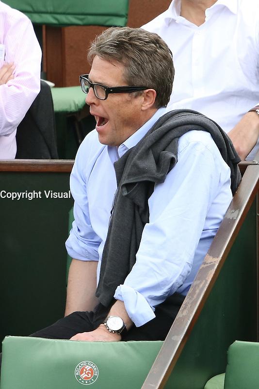 Hugh Grant watching tennis during Roland Garros tennis open 2016 on may 25 2016.