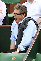 Hugh Grant watching tennis during Roland Garros tennis open 2016 on may 25 2016.