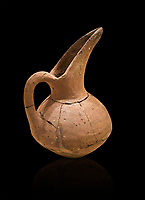 Hittite terra cotta beak spout pitcher . Hittite Period, 1600 - 1200 BC.  Hattusa Boğazkale. Çorum Archaeological Museum, Corum, Turkey. Against a black bacground.