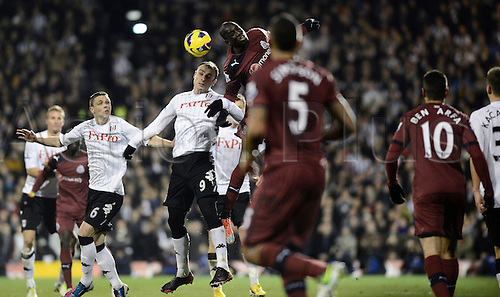 10.12.2012 London, England. Dimitar Berbatov of Fulham and Demba Ba of Newcastle challenge for the ball during the Premier League game between Fulham and Newcastle United from Craven Cottage.