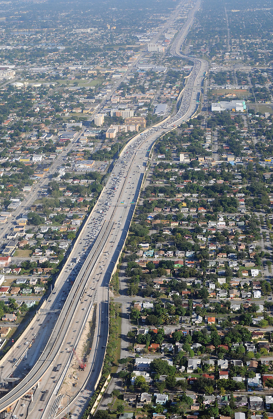 An aerial view of the Miami roadway and suburb, seen from the vantage point of an American Airlines Boeing 737 passenger jet