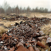 Discarded and rusting ammunition canisters lie piled up in a former exercise terrain of the Soviet army.... CHECK with MRM/FNA