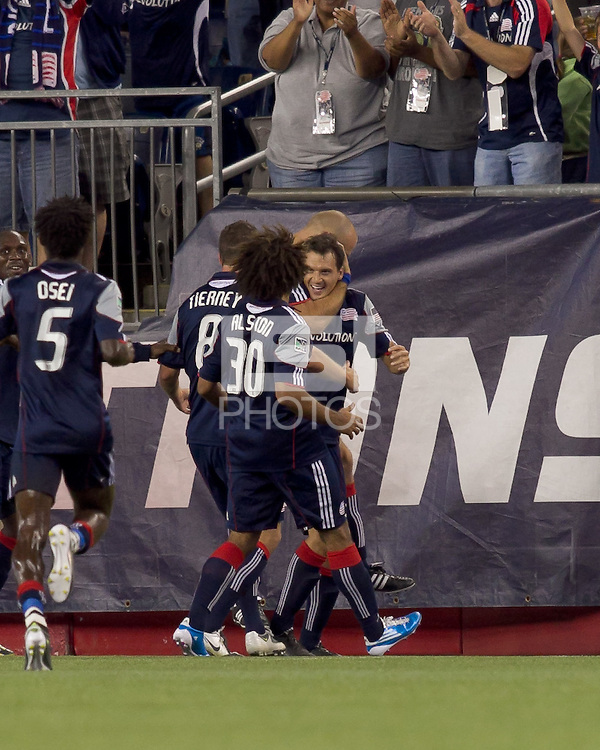 New England Revolution midfielder Marko Perovic (29) celebrates his goal with teammates. The New England Revolution defeated the Seattle Sounders FC, 3-1, at Gillette Stadium on September 4, 2010.