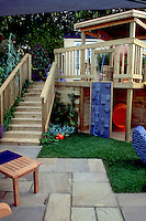 Child's climbing area onto deck with lawn, patio, stairs to raised deck, house, with kids in mind