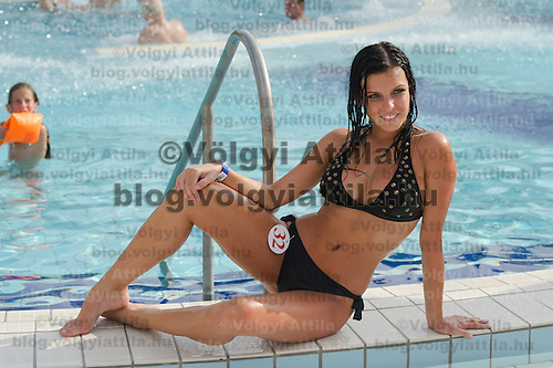 Evelin Szalai poses for photographers after the Miss Bikini Hungary beauty contest held in Budapest, Hungary on August 06, 2011. ATTILA VOLGYI