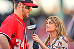 10 June 2012: Washington Nationals outfielder Bryce Harper is interviewed by MASN reporter Kristina Akra after a game against the Boston Red Sox at Fenway Park in Boston, MA. Harper scored the game winning run in the 9th inning as the Nationals defeated the Red Sox 4-3 to sweep their 3-game interleague series. Mandatory Credit: Ed Wolfstein Photo