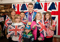 Triple Paralympic medalist Ollie Hynd from Kirkby in Ashfield proudly shows off his 'one of each' collection of swimming medals at ASDA Sutton on Saturday, where he made a personal appearance.  Pictured with Ollie are (from left) Chloe Gregory, 15, Alice Gascoyne, 8, Kurt Fisher, 10, Nathan Barker, 3, Zoe Maxwell, 10 and Demi-Leigh Denby, 9.