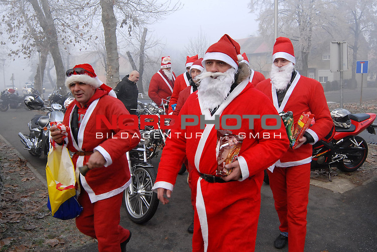 20.12.2013., Slavonski Brod, Croatia - Members of motorcycle clubs form area of Slavonski brod city gathered dressed ad santa clauses during their visit to kindergarten Pcelica (bee), kondergarten Maslacak (dandelion) and children in Josip Bencevic hospital. <br />   Foto &not;&copy; nordphoto /  Ivica Galovic