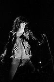 "Denver, Colorado<br /> USA<br /> May 9, 1983<br /> <br /> Front-man and Ramones singer: Joey Ramone in concert.<br /> <br /> The Ramones were an American rock band that formed in Forest Hills, Queens, New York in 1974, often cited as the first punk rock group. Despite achieving only limited commercial success, the band was a major influence on the punk rock movement both in the United States and the United Kingdom.<br /> <br /> All of the band members adopted pseudonyms ending with the surname ""Ramone"", though none of them were actually related. They performed 2,263 concerts, touring virtually nonstop for 22 years. In 1996, after a tour with the Lollapalooza music festival, the band played a farewell show and disbanded.<br /> <br /> By a little more than eight years after the breakup, the band's three founding members--lead singer Joey Ramone, guitarist Johnny Ramone, and bassist Dee Dee Ramone--had all died."