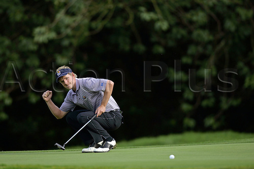 23 September 2006: European player Luke Donald celebrates holing out on the 16th green during his foursomes match with Toms against Garcia and Donald during the second day of The 2006 Ryder Cup played at The K Club, Straffan, County Kildare, Ireland. Garcia and Donald won the match 2 & 1 Photo: Glyn Kirk/Actionplus...060923 golf golfer joy celebration putting