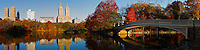 Central Park (New York) Panorama in Fall as seen from the South side of the Lake and looking North West.  Visible structures include the Majestic Apartments (far left), San Remo Apartments (middle), and Bow Bridge (right).
