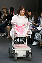 Disabled model Ami Sano sits on an electric wheelchair and poses on the catwalk wearing clothes from the tenbo 2016 Spring-Summer Collection during the Mercedes-Benz Fashion Week Tokyo, in Roppongi on October 13, 2015, Tokyo, Japan. tenbo invited people with disabilities to join models and celebrities on the runway in a message of peace. The Mercedes-Benz Fashion Week Tokyo runs from October 12 to 17. (Photo by Rodrigo Reyes Marin/AFLO)
