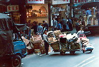 Transporting food products in busy street  market.Pictures taken in Canton China in 1977 at the time of the cultural revolution.
