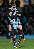 Winning goalscorer Jason McCarthy of Wycombe Wanderers celebrates with Luke O'Nien of Wycombe Wanderers on the final whistle during the Sky Bet League 2 match between Wycombe Wanderers and Oxford United at Adams Park, High Wycombe, England on 19 December 2015. Photo by Andy Rowland.