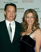 Washington, D.C. - December 2, 2006 -- Tom Hanks and Rita Wilson arrive for the State Department Dinner for the 29th Kennedy Center Honors dinner at the Department of State in Washington, D.C. on Saturday evening, December 2, 2006.  Andrew Lloyd Webber, Zubin Mehta, Dolly Parton, Smokey Robinson and Stephen Spielberg are being honored in 2006 for their contribution to American culture..Credit: Ron Sachs / CNP