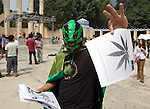 A Mexican wrestler delivers marijuana propaganda prior to a rally demanding decriminalization of drug posession after Mexican Congress approved a drug law on April 29 to legalize the possession of small quantities of drugs and mandate treatment for addicts, May 6, 2006 Mexican President Vicente Fox refused to sign a drug decriminalization bill on Wednesday. Photo by Javier Rodriguez