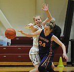 Ketchikan's Ashley Huffine knocks the ball away from Lathrop's Aislynn Odsather in their Dimond Lady Lynx Prep Shootout basketball game Friday, February 10, 2017.  Photo for the Daily News by Michael Dinneen